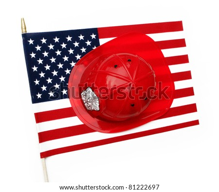 Red fire fighter helmet hat on US flag isolated on a white background