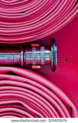 Red fire hose