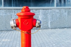 Red fire hydrant, a fire hydrant on the street.