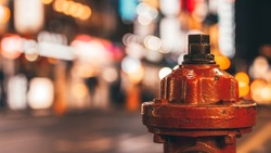 Red fire hydrant, a fire hydrant on the street with bokeh in background