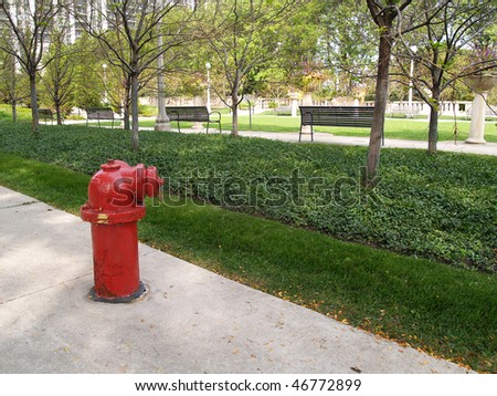 Red fire hydrant in a Chicago, Illinois, city park.