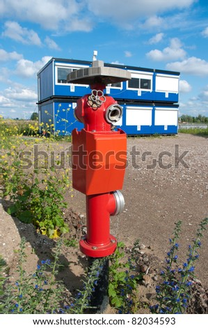 red fire hydrant on an industrial area
