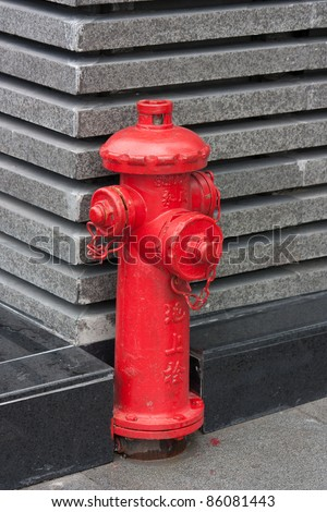 Red fire hydrant with Chinese letters \