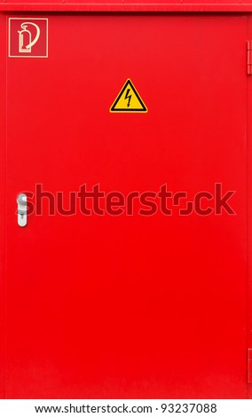 Red fire protection door with two signs