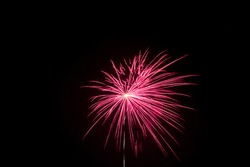 red firework and black background