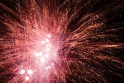 Red fireworks explosions in the night sky