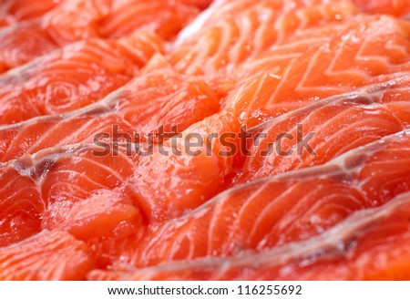 red fish sliced pieces laid out on a plate - stock photo