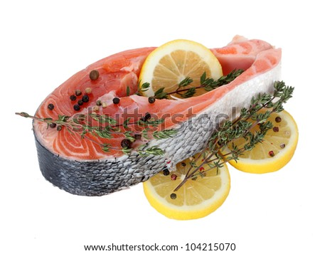 Red fish with lemon and thyme isolated on white