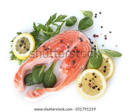 Red fish with lemon, parsley and pepper isolated on white