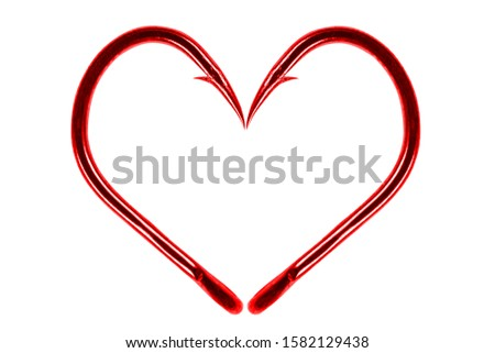 Red fishing hook love heart sign isolated on a white background. Fishing hook close up. Fishing tackle. Stainless steel hooks. Fish hooks in heart shape. The concept of love of fishing.