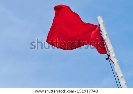 Red flag and blue sky