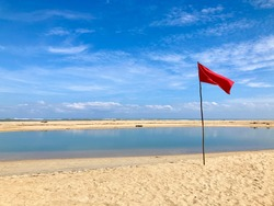 Red Flag at the beach caution to play water