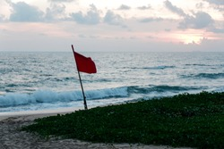 Red Flag Fly on Beach at Evening Sunset Times Still Life Photography