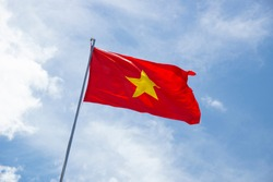 Red flag of Vietnam developing in the wind.