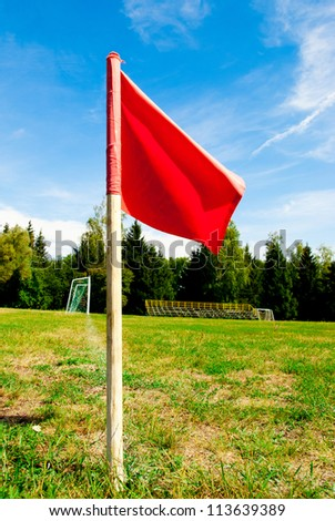 red flag on a green football field