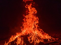 Red flames in a bonfire