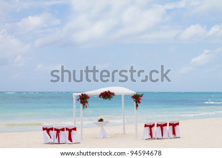 Red Flowers at the Beach placed for a wedding in Tulum Mexico