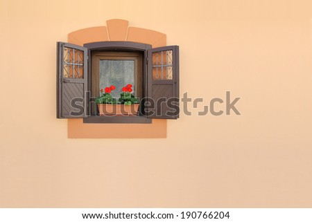 Red flowers on a old brown wooden window