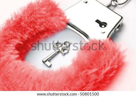Red fluffy handcuffs with key