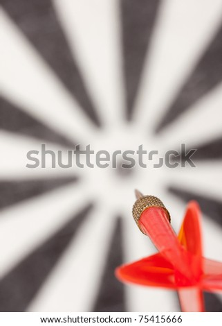 Red flying dart to dartboard bull's eye