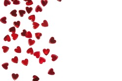 Red foil heart shaped confetti isolated on white backround. Valentine's day template with copy space