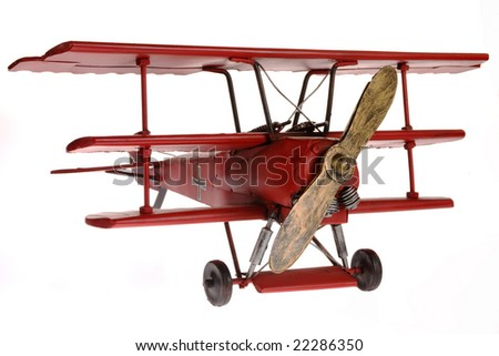 Red Fokker triplane isolated on white background
