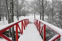 Red Foot Bridge on Snowy Day