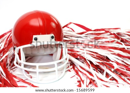 Red football helmet and pom poms isolated on white background.