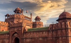 Red Fort Delhi at sunset with moody sky - A UNESCO World heritage site.