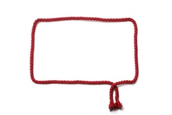 Red frame is made with cord for knitting. It is empty and isolated on white.
