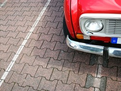 Red french small car of the seventies and eighties with chrome bumper in Schloss Holte-Stukenbrock in East Westphalia, Germany