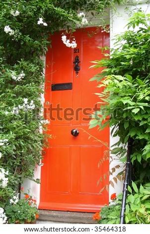 Red front door and flowers.