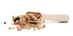 Red fruits cereal mix with wooden spoon, fruity and crunchy muesli with dried raspberry, strawberry, cherry chunks isolated on white background