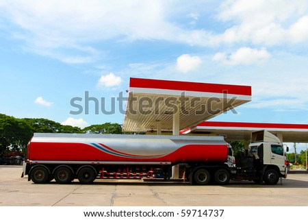 Red fuel truck in gas station
