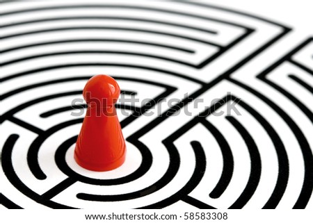 red game figurine in labyrinth, off-center