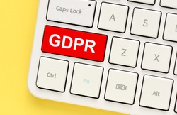 Red GDPR button on a white keyboard. GDPR (general data protection regulation) concept