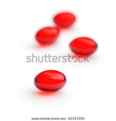 Red gel capsules. Selective focus. Isolated on white background.