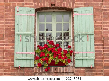 Window With Red Color Wooden Shutters In Red Brick House Wall