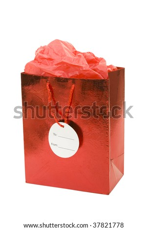 Red gift bag with tissue on white background