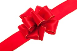 Red gift bow in front of white background