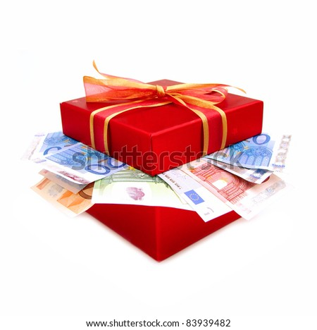 Red gift box and bow with money flowing out from inside