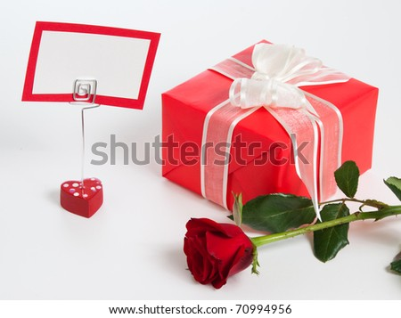 red gift box and paper holder and red rose isolated on white