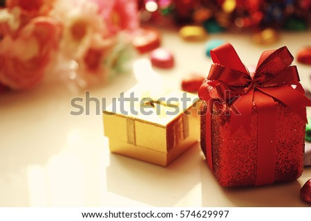 red gift box golden ring box and heart chocolateflower blurry backgroundselective focus - Christmas Ornament Ring Box