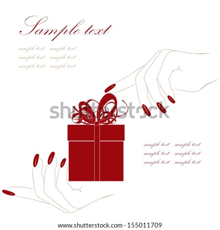 Red gift box in a hand
