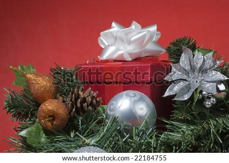 Red gift box on Christmas tree