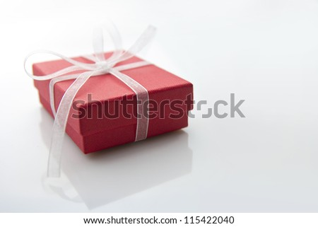 red gift box on white table