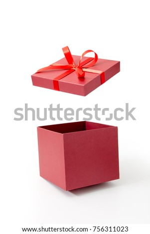 Red gift box open with ribbon isolated on white background #756311023