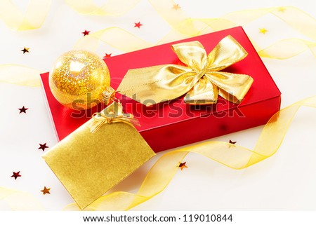 Red Gift box with gold ribbon and gift card