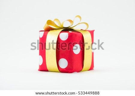 Red gift box with gold ribbon isolated on white background. #533449888