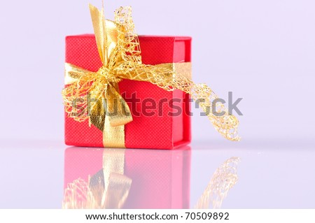 red gift box with its reflection